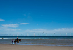 © Licensed to London News Pictures. <br /> 08/06/2014. <br /> <br /> Redcar, United Kingdom<br /> <br /> A horse is ridden along the waters edge on Majuba beach in Redcar, Cleveland.<br /> <br /> Photo credit : Ian Forsyth/LNP