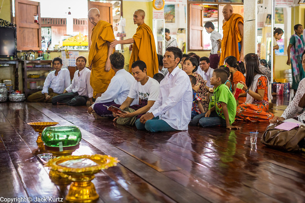 24 MAY 2013 - MAE SOT, THAILAND: Burmese monks walk into in Wat Pha Mai for Visakha Puja Day services. Visakha Puja (Vesak) marks three important events in the Buddha's life: his birth, his attainment of enlightenment and his death. It is celebrated on the full moon of the sixth lunar month, usually in May on the Gregorian calendar. This year it is on May 24 in Thailand and Myanmar. It is celebrated throughout the Buddhist world and is considered one of the holiest Buddhist holidays. Burmese Buddhist in Mae Sot celebrated with a procession through Mae Sot that ended with a service followed by a communal meal at Wat Pha Mai, the most important Burmese Buddhist temple in Mae Sot.   PHOTO BY JACK KURTZ