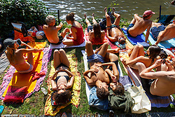 © Licensed to London News Pictures. 13/09/2016. London, UK. People sunbathe at Hampstead Heath Mixed Bathing Pond in north London as temperatures hit 30C in London on Tuesday, 13 September 2016. Photo credit: Tolga Akmen/LNP