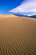 Morning light on dune patterns under the Sangre de Cristo Mountains, Great Sand Dunes National Park, Colorado  .