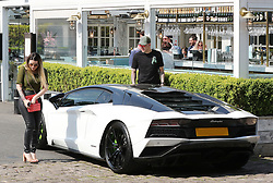 Manchester City goalkeeper Ederson gets into his white Lamborghini Aventador with his wife Lais Moraes as they leave Piccolino Restaurant in Alderley Edge, Cheshire on Monday afternoon.