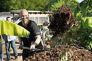 Democratic presidential hopeful Senator Cory Booker helps shovel compost in a banana patch during a visit to Fresh Future Farm April 27, 2019 in North Charleston, South Carolina. Booker spent his 50th birthday helping out at the urban farm as part of his Justice For All tour.
