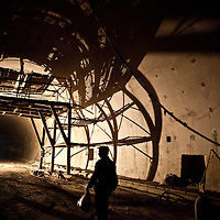 A construction worker walks through the tunnel from which cars will emerge onto the bridge span. An estimated 10,000 cars can cross the bridge daily. The total cost of the bridge was nearly 1.5 billion yuan , equal to 50 million euros.