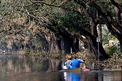 05 Sept  2005. New Orleans, Louisiana. Post hurricane Katrina.<br /> Uptown New Orleans off Napolean Ave has been submerged by the devastating floods. A couple take a canoe ride along Napolean.<br /> Photo; ©Charlie Varley/varleypix.com