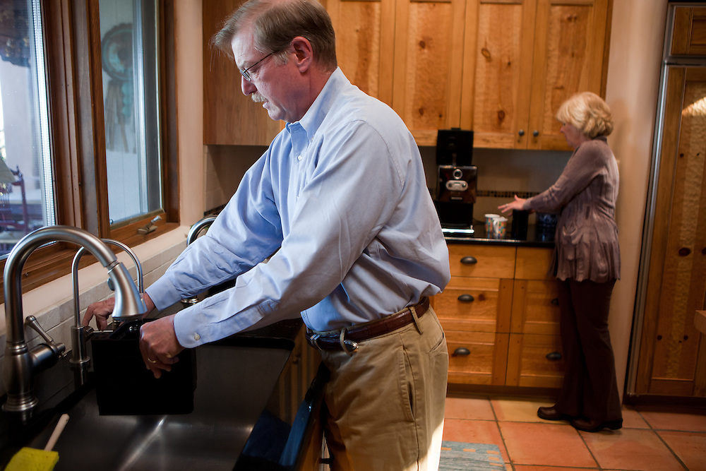 Former Merrill Lynch executive James A. Brown and his wife Nancy make coffee in the kitchen of their Santa Fe New Mexico home on October 15, 2010...Credit: Steven St. John for The Wall Street Journal.ENRON