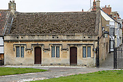 Early to mid C19 cottages in free Tudor style, in St John's churchyard, Devizes, Wiltshire, England, UK