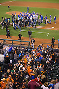 San Francisco Giants fans leave the stands as Chicago Cubs celebrates beating the San Francisco Giants in Game 4 of the NLDS, and clenching a spot in the NLCS, at AT&T Park in San Francisco, Calif., on October 11, 2016. (Stan Olszewski/Special to S.F. Examiner)