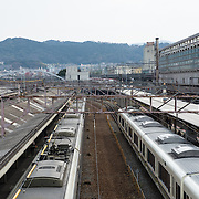 Trains on platform at a station in Kyoto.