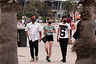 Beachgoers are seen walking along the St Kilda Foreshore during the final days of the worlds toughest and longest COVID-19 restrictions in St Kilda.  With 21 days of zero new cases, Premier Daniel Andrews is expected to announce major easing of restrictions, including masks, at his press conference on Sunday. (Photo by Dave Hewison/Speed Media)