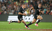 Aaron Cruden of the All Blacks on the burst with Malakai Fekitoa of the All Blacks in support during the third rugby test between the All Blacks and England played at Waikato Stadium in Hamilton during the Steinlager Series - All Blacks v England, Hamiton, 21 June 2014<br /> www.photosport.co.nz
