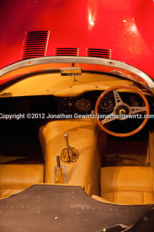 A view from above into the driver's cockpit of a right-hand drive Jaguar E-Type convertible sports car. WATERMARKS WILL NOT APPEAR ON PRINTS OR LICENSED IMAGES.