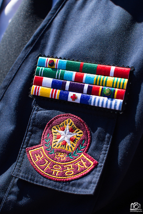 Badges decorate the uniform of an unidentified Korean War Veteran during the Memorial Day Ceremony at Milpitas City Hall's Veterans Plaza in Milpitas, California, on May 26, 2014. (Stan Olszewski/SOSKIphoto)