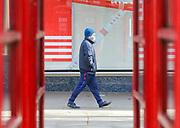 25th February, Cheltenham, England. A man walks down the Promenade area in Cheltenham wearing a mask.