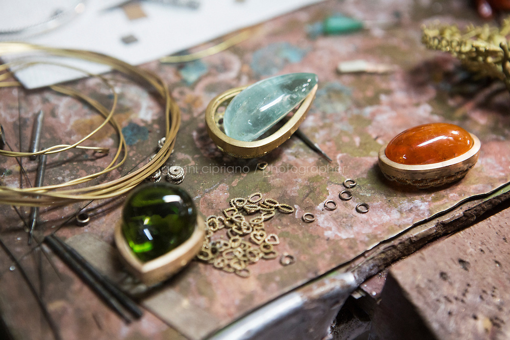 CATANIA, ITALY - 15 FEBRUARY 2016: (L-R)  A peridot, an acquamarine from Brazil and a mandarin garnet from the Jewels of the Sea collection are set up here on the working table of jeweler Massimo Izzo in his atelier in Siracusa, Italy, on February 15th 2016.<br /> <br /> Massimo Izzo is a designer and creator of high-end jewelry inspired by Sicily and the Mediterranean culture.