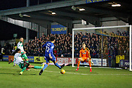AFC Wimbledon forward Tyler Burey (32) sees this shot saved by Plymouth goalkeeper Matt Macey during the EFL Sky Bet League 1 match between AFC Wimbledon and Plymouth Argyle at the Cherry Red Records Stadium, Kingston, England on 26 December 2018.