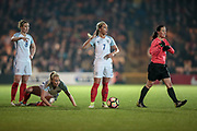 Jordan Nobbs (vice-captain) (England) (Arsenal), Toni Duggan (England) (Manchester City) and Jade Moore (England) (Notts County) wait to take a free kick as Morag Pirie (Referee) (Scotland) goes to direct the Italy Ladies wall back the correct distance during the Women's International Friendly match between England Ladies and Italy Women at Vale Park, Burslem, England on 7 April 2017. Photo by Mark P Doherty.