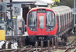 © Licensed to London News Pictures. 15/09/2017. London, UK. Police can be seen next to an abandoned tube train at Parsons Green Station after a small explosion during the morning rush hour. A number of casualties have been reported. Photo credit: Peter Macdiarmid/LNP