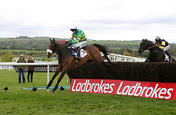 Don't Touch It ridden my jockey Mark Walsh on the way to winning the pigsback.com Nick Coen Memorial Handicap Chase during day three of the Punchestown Festival in Naas, Co. Kildare.