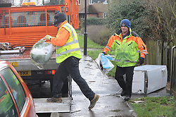 © Licensed to London News Pictures. 06/01/2014<br /> Maidstone Council workmen clear out property in Yalding<br /> Yalding village Flood water starts receding again as a clear up operation starts.<br /> The village in Kent also gets a visit from the new Kent Police Chief Constable Alan Pughsley and Kent Police Commissioner Ann Barnes who walked around Little Venice Country Park meeting residents.  Alan Pughsley has been in the post since January 4th 2014.<br /> Photo credit :Grant Falvey/LNP