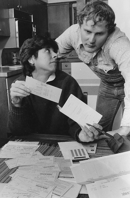 ©1989 Husband and wife working on their finances at home, Austin, Texas  MR
