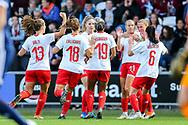 Switzerland players celebrate their first goal (2-1) scored by Lara Dickenmann (#11) of Switzerland during the 2019 FIFA Women's World Cup UEFA Qualifier match between Scotland Women and Switzerland at the Simple Digital Arena, St Mirren, Scotland on 30 August 2018.