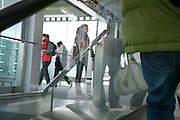 passengers walking through a glass terminal