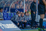 Interim Celtic Manager Neil Lennon consults with his staff during the Ladbrokes Scottish Premiership match between Rangers and Celtic at Ibrox, Glasgow, Scotland on 12 May 2019.