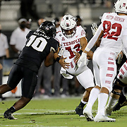 ORLANDO, FL - NOVEMBER 14:  Eriq Gilyard #10 of the Central Florida Knights strips the ball from Re-al Mitchell #13 of the Temple Owls at Bounce House-FBC Mortgage Field on November 14, 2020 in Orlando, Florida. (Photo by Alex Menendez/Getty Images) *** Local Caption *** Eriq Gilyard; Re-al Mitchell