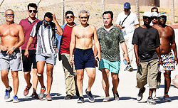 """August 15, 2017 - Mugla, Turkey - August 15, 2017 - Mugla, Turkey - Saudi Prince Talal bin Abdulaziz al-Saud (C) walks on the streets of the Aegean province of Mugla's Bodrum, in Turkey, during his holiday on August 15. The prince and his family were enjoying the second day of their luxury holiday in the Turkish resort. A numbers of bodyguards accompanied the prince as he toured Bodrum's Türkbükü area.   Local authorities also tightened security measures in the area, with gendarmerie forces on duty on the streets used by the Saudi prince. Prince Talal later returned to the hotel which he is staying, and at noon he and his family took a special yacht from Bodrum's Göltürkbükü. The ultra-luxurious yacht, named """"Kingdom 5 KR,"""" hosts a helicopter on its room. Speedboats were stationed around the yacht while Prince Talal and his family rode jet-skis. The prince and his family had arrived in Bodrum early on Aug. 14 for a holiday. (Credit Image: © Yasar Anter/Depo Photos via ZUMA Wire)"""