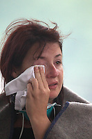 A women cries after the aftermath after a Powerful earth quack ripped through Christchurch, New Zealand on Tuesday lunch time killing at least 65 people as it brought down buildings, buckled roads and damaged churches and the Cities Cathedral. Photo Tim Clayton