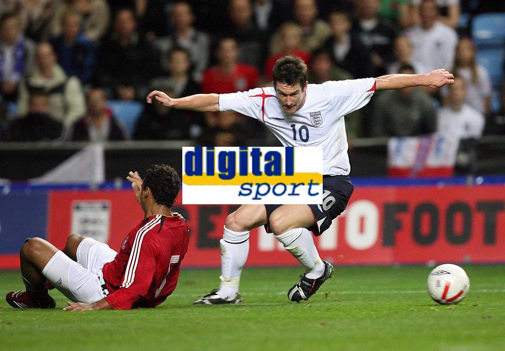 Photo: Rich Eaton.<br /> <br /> England U21 v Germany U21. UEFA European Championship Play-Off 1st Leg. 06/10/2006. David Nugent right of England turns inside Marvin Matip of Germany