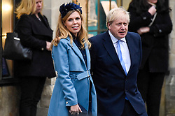 © Licensed to London News Pictures. 09/03/2020. LONDON, UK. Boris Johnson, Prime Minister, and fiance Carrie Symonds leave Westminster Abbey after attending the annual church service on Commonwealth Day.  Photo credit: Stephen Chung/LNP