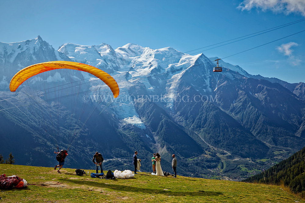 Paragliding from La Flégère overlooking the French Alps with Mont Blanc in the background - Chamonix, France