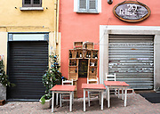"""Luino, Lombardia. ITALY.   """"Luino Old Town"""" Bar/Restaurant , tables laid out for lunch time clients narrow streets, hilly, situated, on the side of Lake Maggiore, Province of Varese.. ITALY <br /> <br /> <br /> Monday  02/01/2017  <br /> <br /> © Peter SPURRIER,<br /> <br /> <br /> LEICA CAMERA AG LEICA Q (Typ 116). ISO 100  f3.2  28mm"""