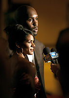 Jun 27, 2004; Los Angeles, CA, USA; NBA LIfetime Achievement Award Honoree GARY PAYTON with his wife MONIQUE being interviewed by the news media @ The 19th Annual Cedars-Sinai Sports Spectacular inside the Century Plaza Hotel in Century City, CA.  Mandatory Credit: Photo by Shelly Castellano/ZUMA Press. (©) Copyright 2004 by Shelly Castellano