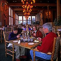 A family eats in the dining room at Huntley Lodge, part of Montana's Big Sky Ski and Summer Resort.