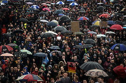 © Licensed to London News Pictures. 05/06/2017. Newcastle Upon Tyne, UK.  A crowd of hundreds listens to a speech by Jeremy Corbyn MP, Leader of the Labour Party, after they waited in the rain to hear him speak outside the Sage in Gateshead. Mr Corbyn spent one of the final days of the campaign trail in the Labour heartlands of North-East England before voters go to the polls in the UK General Election on June 8th 2017. Photo credit: MARY TURNER/LNP