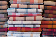 Traditional checks, plaid and highland tartan lambswool throws and textiles on display for sale at Lochcarron Weavers in Lochcarron in the Highlands of Scotland