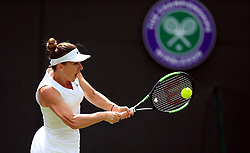 Simona Halep in action on day one of the Wimbledon Championships at the All England Lawn Tennis and Croquet Club, Wimbledon.