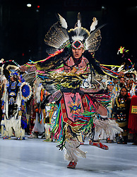 April 28, 2017 - Albuquerque, NM, U.S. - Xavier Little Head of Lame Deer MT. dances as he introduced during the Grand Entrance at the 2017 Gathering of Nations Pow-Pow.  Friday April 28, 2017. (Credit Image: © Jim Thompson/Albuquerque Journal via ZUMA Wire)
