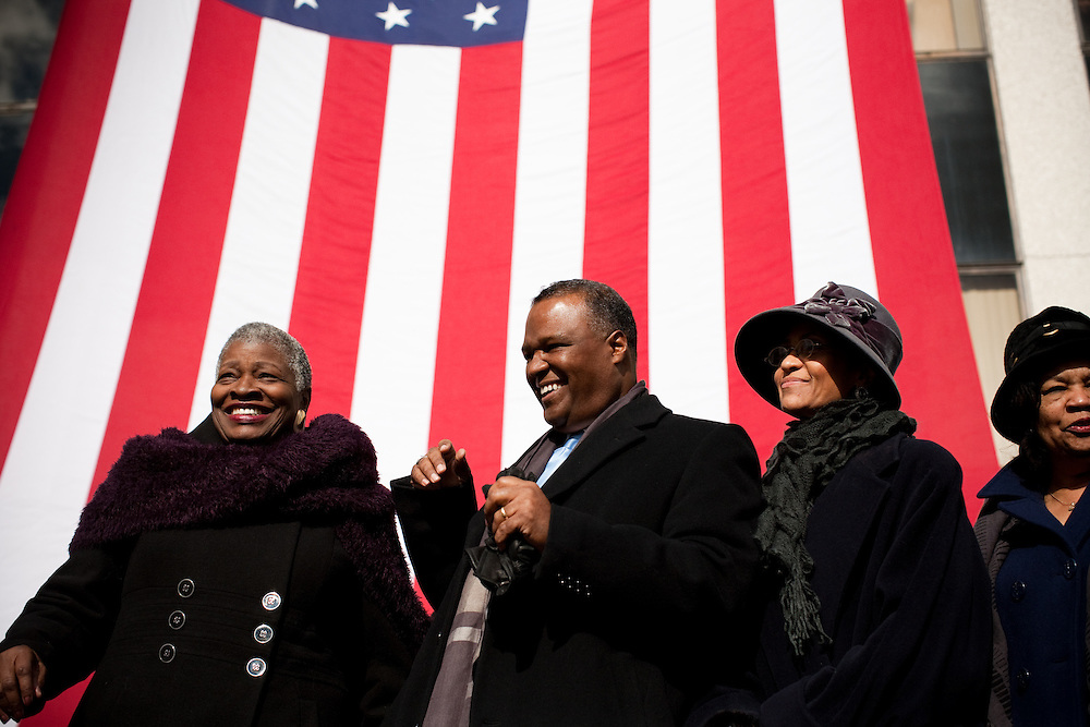 UPPER MARLBORO, MD - DECEMBER 6: Prince George's County Executive-Elect Rushern Baker III (center) laughs with District 7 County Councilmember Dorothy Bailey (left) and his wife Christa beverly Baker (right) before the inauguration ceremony at Prince George's County Administration Building on his inauguration day on December 6, 2010 in Upper Marlboro, Maryland. (Photo by Michael Starghill, Jr.)