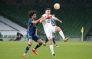 Mohamed Elneny of Arsenal with Dundalk's Patrick McEleney during the Europa League Group B match between Dundalk and Arsenal at Aviva Stadium, Dublin, Republic of Ireland on 10 December 2020.