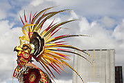 """A dancer performs with his group """"Tlalok,"""" which dances in traditional central Mexican style, during the South Park Bridge Grand Opening celebration on June 29, 2014 in Seattle.<br /> Maddie Myer / The Seattle Times"""