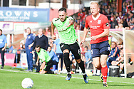 Jordan Burrow of York City (15) attacks whilst chased by Daniel Morton of Curzon Ashton (6) during the Vanarama National League North match between York City and Curzon Ashton at Bootham Crescent, York, England on 18 August 2018.