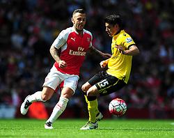 Jack Wilshere of Arsenal closes down Ashley Westwood of Aston Villa - Mandatory by-line: Dougie Allward/JMP - 15/05/2016 - FOOTBALL - Emirates Stadium - London, England - Arsenal v Aston Villa - Barclays Premier League