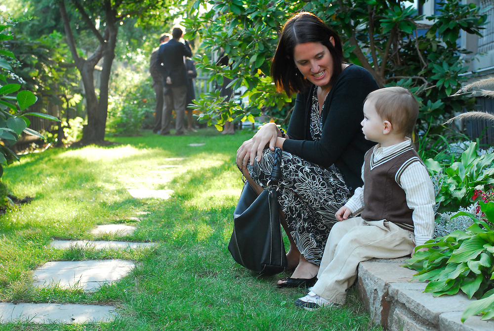 A boy and his mother wait for the backyard wedding ceremony in Dorchester, MA.