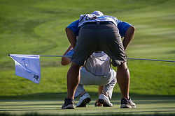 August 5, 2018 - Reno, Nevada, U.S - Sunday, August 5, 2018.CHAD CAMPBELL and his caddie look for a clean line on the 18th green during the 2018 Barracuda Championship at the Montreux Golf & Country Club. ..The Barracuda Championship Golf Tournament is one of only 47 stops on the PGA Tour worldwide, and has donated nearly $4 million to charity since 1999. Opened in 1997, the par-72 course was designed by Jack Nicklaus, plays at 7,472 yards (6,832 m) and its average elevation is 5,600 feet (1,710 m) above sea level...The Montrux Golf and Country Club is located midway between Reno and Lake Tahoe...Campbell placed second, 4 points behind tournament champion, Andrew Putnam. (Credit Image: © Tracy Barbutes via ZUMA Wire)