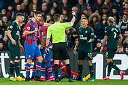 Peter Bankes (Referee) calming down players after awarding a yellow card to Joelinton Apolinarion De Lira (Newcastle United) during the Premier League match between Crystal Palace and Newcastle United at Selhurst Park, London, England on 22 February 2020.