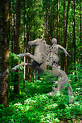 Bronze horseman and horse in a forest. Digitally manipulated image