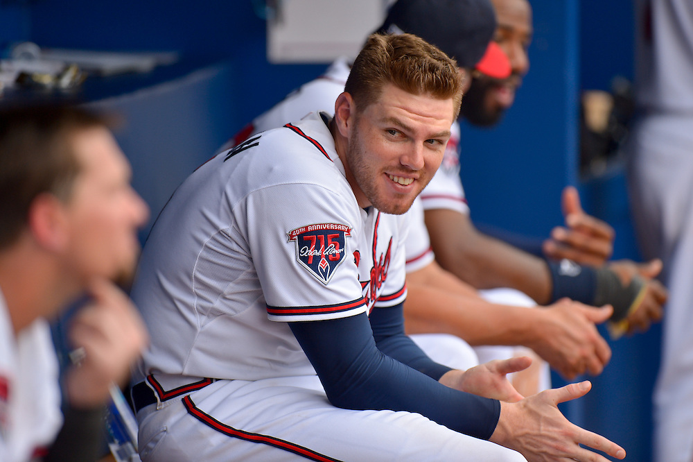 ATLANTA, GA - JUNE 18:  Freddie Freeman #5 of the Atlanta Braves has a laugh with teammates in the dugout against the Philadelphia Phillies at Turner Field on June 18, 2014 in Atlanta, Georgia. (Photo by Kevin Liles/Getty Images)  *** Local Caption *** Freddie Freeman